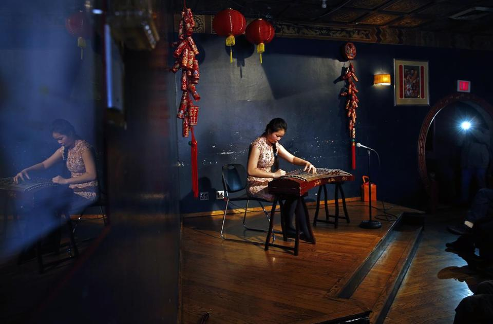 Rachele Huo plays a guzheng, or Chinese zither, a traditional plucked musical string instrument, this one with 21 strings, for the Spring Festival performance at the Hong Kong.