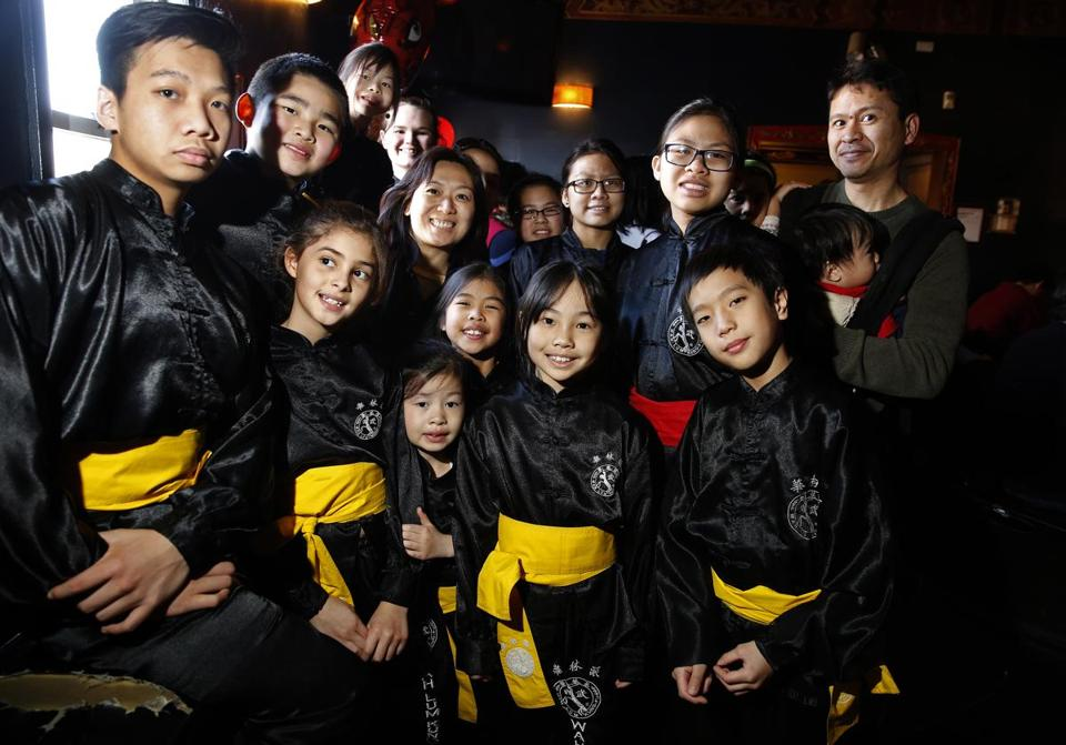 Cambridge, MA 2/29/16 5. Left to Right and Top to Bottom: Quang Nguyen, Timothy Du, Annabelle Eckhardt, Hannah Lydon, Sifu Mai Du, Kelly Le, Yen-Nhi Chit, Linh-Nhi Chit, David Doroquez, Jaelize McCabe, Lorelei Eckhardt, Alana Doroquez, Kara Cheung, and Jayden Tran, Wah Lum Kung Fu practitioners pose before they perform at the Hong Kong Restaurant and Lounge for Spring Festival.