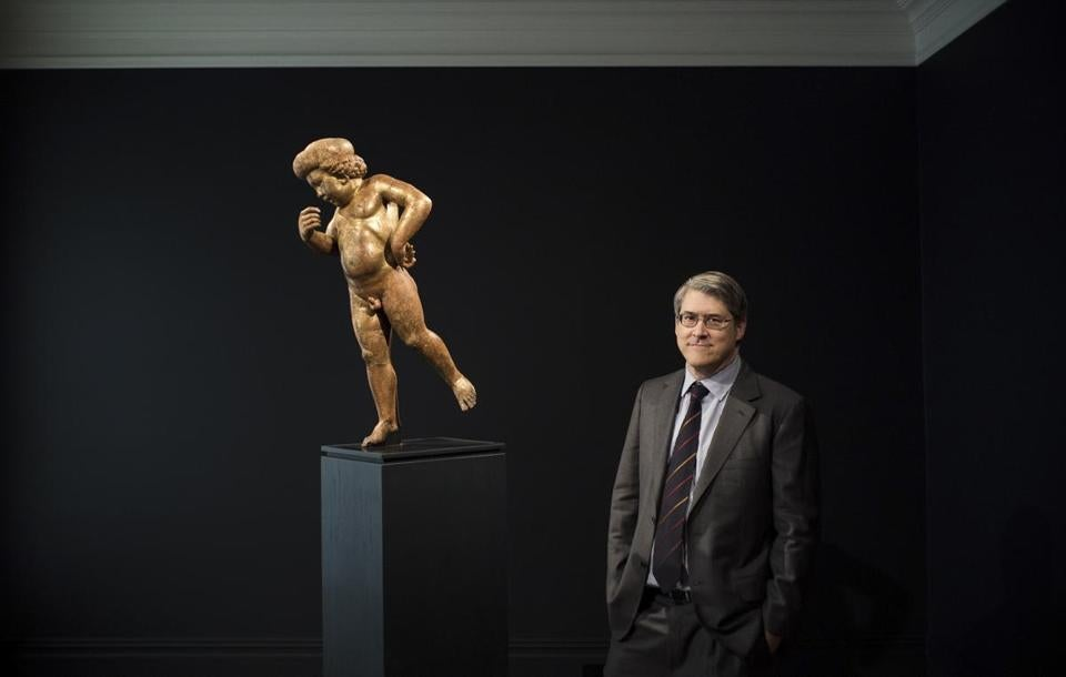 Renaissance scholar Andrew Butterfield with a wooden, gilded cherub that he and several other experts believe is a lost work by Donatello.