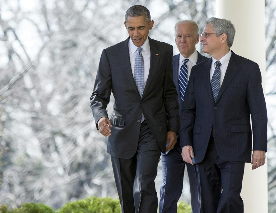 Federal appeals court judge Merrick Garland walks with President Barack Obama and Vice President Joe Biden from the Oval Office to the Rose Garden to be introduced as Obama's nominee for the Supreme Court on Wednesday, March 16, 2016.
