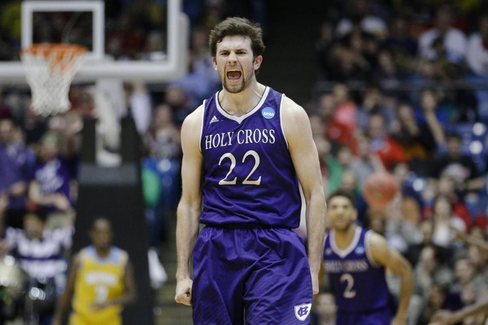 Holy Cross' Robert Champion reacts after hitting a 3-pointer during the 2016 NCAA basketball tournament. Holy Cross could change its Crusader mascot and moniker Saturday.