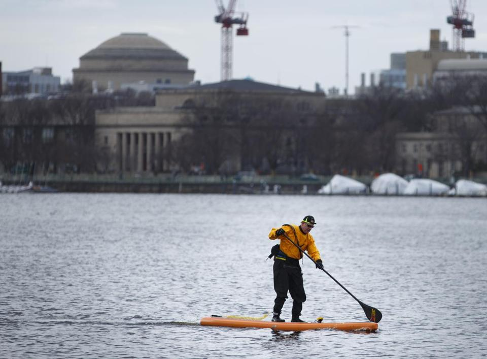 A paddleboarder braved the chill to row along the Charles River last week.