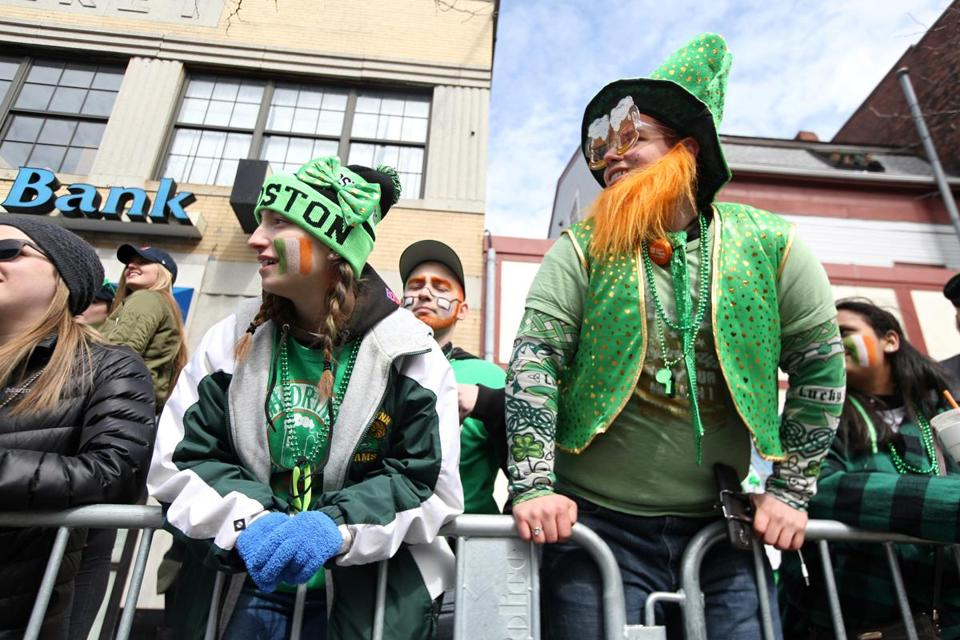 Costumed spectators watch the St. Patrick's Day Parade in South Boston on Sunday.
