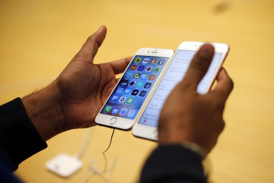 FILE - In this Friday, Sept. 25, 2015, file photo, a customer tries out a new Apple iPhone 6S at an Apple store in Chicago. The FBI now says that it may have a way to crack into an iPhone used by one of the San Bernardino shooters, despite previous claims that it could only achieve that with Apple's help, but it remains unclear exactly how it plans to do that. (AP Photo/Kiichiro Sato, File)
