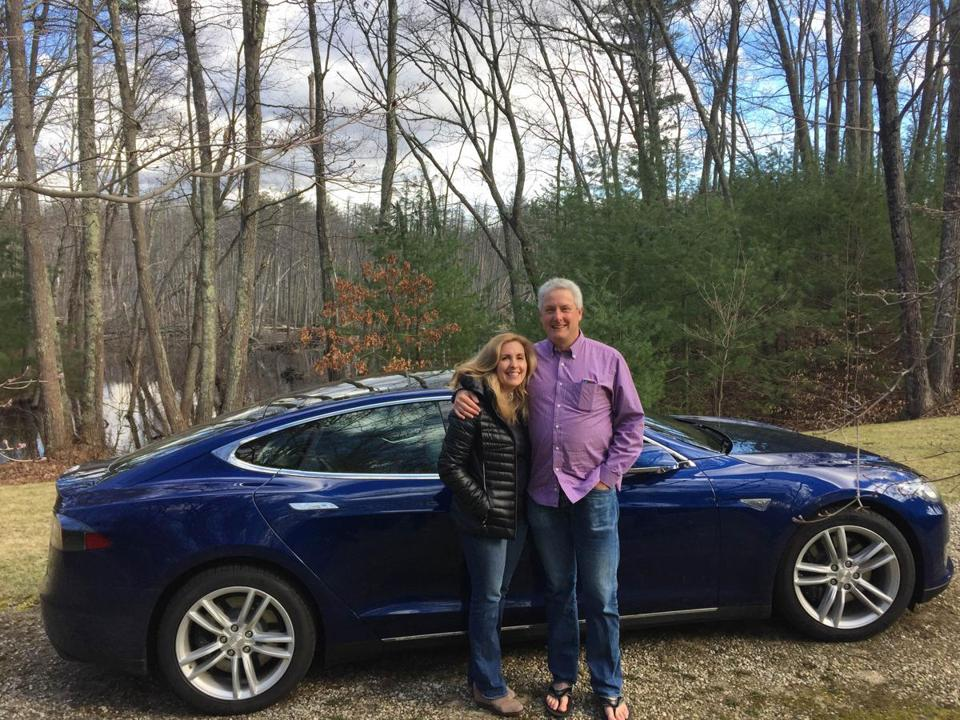 Al and Catherine Nierenberg won a new Tesla in a raffle held by ClimateXChange.