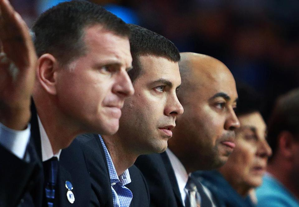 03/16/16: Boston, MA: The Celtics were crushed by the Thunder tonight, and the coaching staff (left to right), assistant coach Walter McCarty, assistant coach Jay Larranaga, head coach Brad Stevens, and assistant coach Micah Shrewsberry had front row seats for the romp. The Boston Celtics hosted the Oklahoma City Thunder in a regular season NBA basketball game at the TD Garden. (Globe Staff Photo/Jim Davis) section:sports topic:celtics-thunder