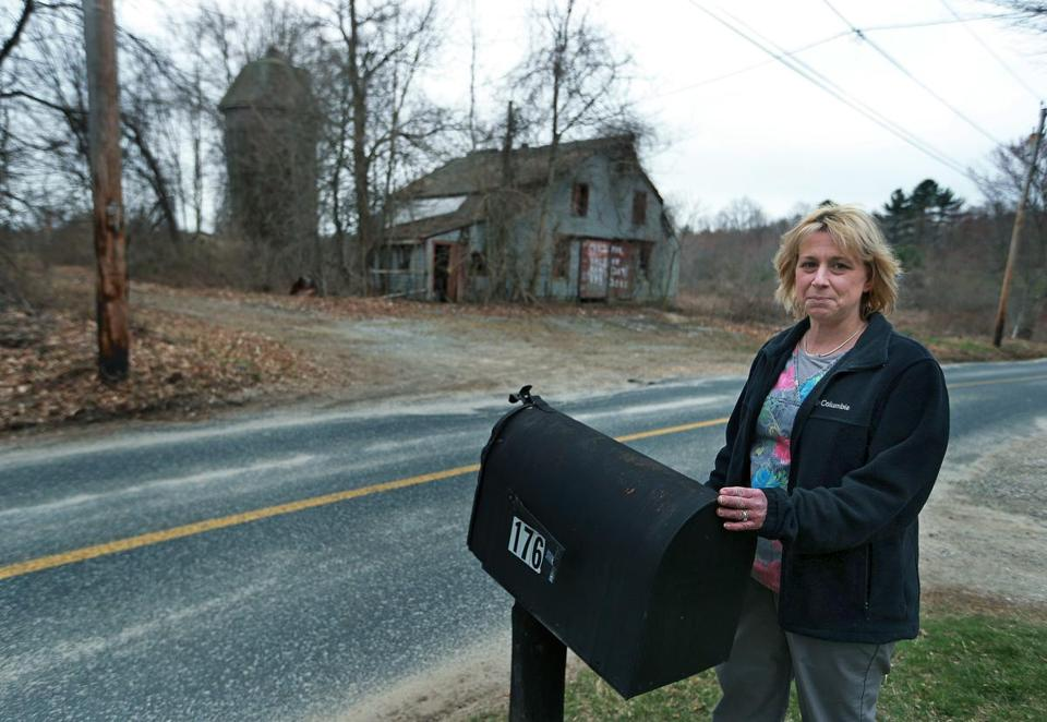 Dudley resident Desiree Moninski was pictured in a March 24 photo in front of her house, across the street from the site where the Islamic Society of Greater Worcester wants to build a cemetery in the town of Dudley.