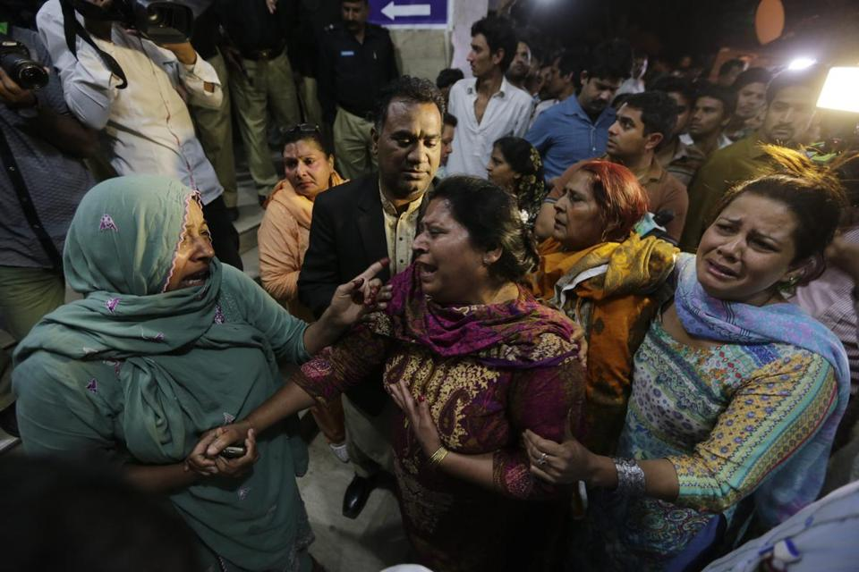 Relatives of the victims of a bomb blast cried outside a hospital in Lahore.