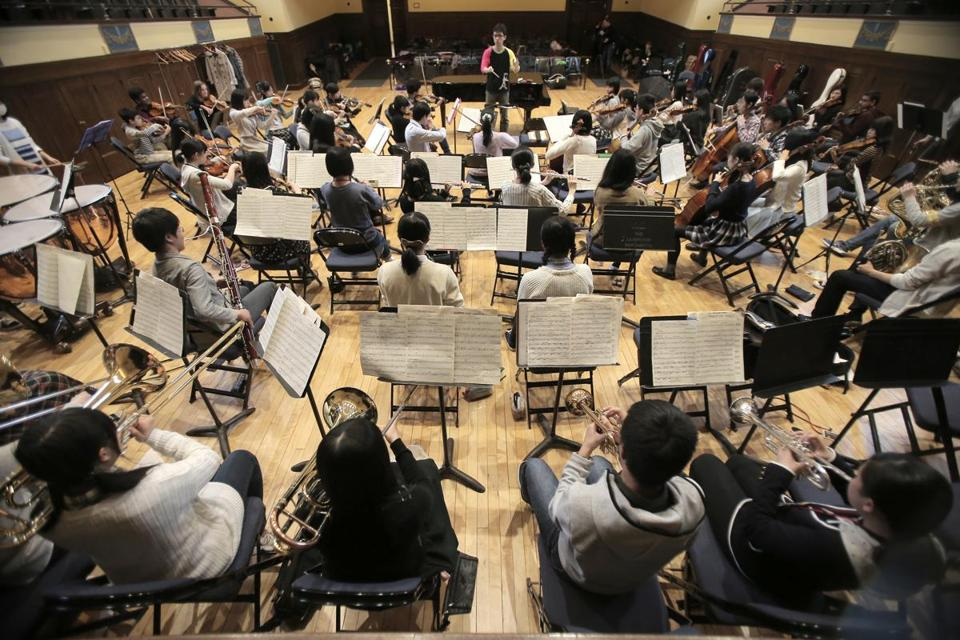 A recent rehearsal of the Fukushima Youth Sinfonietta, an ensemble of young Japanese musicians, at Battin Hall in Lexington.