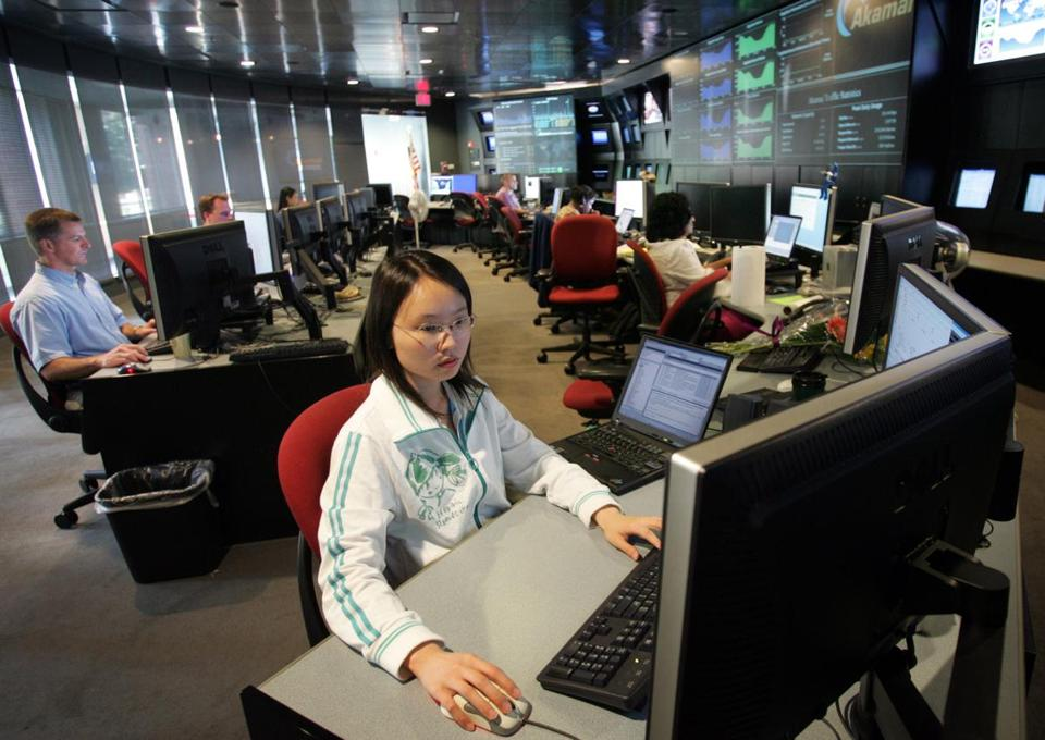 In this 2006 file photo, Eva Chan studied her screen at Akamai Technologies Inc. in Cambridge.