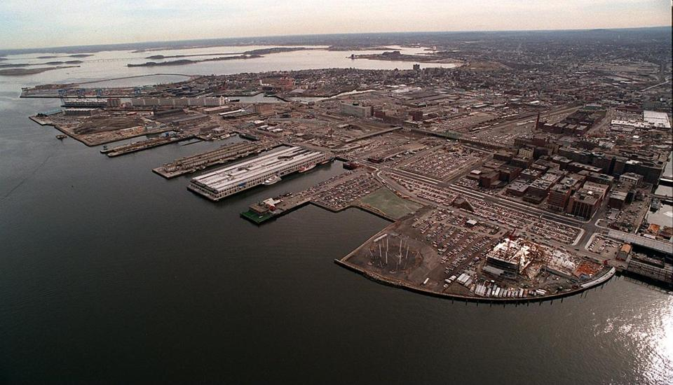 Parking was once plentiful on the South Boston Waterfront, as this photo of construction of the federal courthouse on Fan Pier shows; it opened in 1999. But since then, high-rises have been rapidly replacing empty lots.