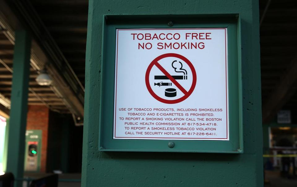 New signs at Fenway Park inform fans of the policy change.