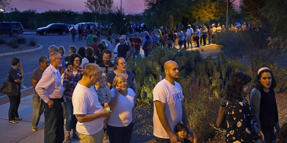 People waited in line in Chandler, Ariz. to vote in the state's presidential primary on March 22.
