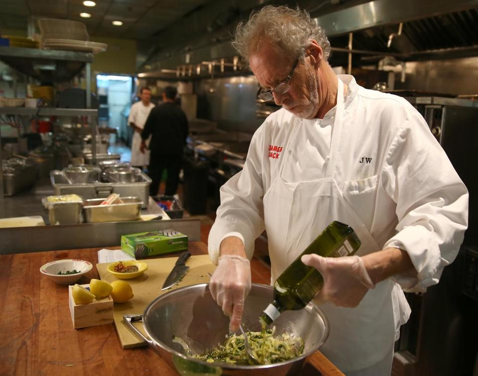Jasper White prepares his grandmother's recipe for baccala salad.