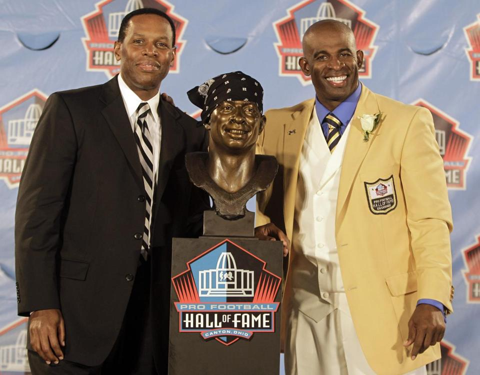 Eugene Parker (left) posed with client Deion Sanders during Sanders' induction ceremony at the Pro Football Hall of Fame in 2011.