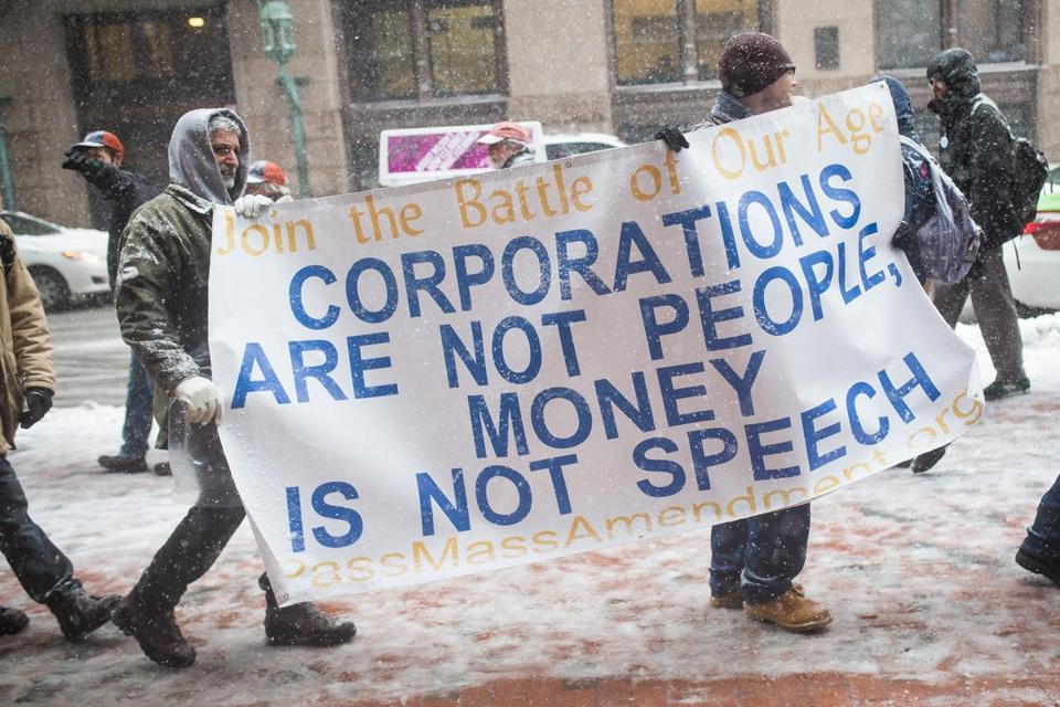 Boston, MA - 4/4/2016 - Demonstrators participate in a protest against General Electric's move to the city of Boston outside of a press conference with General Electric CEO Jeffrey R. Immelt was scheduled to speak in Boston, MA, April 4, 2016. (Keith Bedford/Globe Staff)