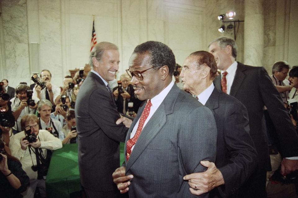 Supreme Court Justice nominee Clarence Thomas is escorted by Sen. Strom Thurmond (R-S.C.), second from right, and Sen. John Danforth (R-Mo.), right, while walking past Senate Judiciary Committee Chairman, Sen. Joseph Biden (D-Del.), left, on Capitol Hill in Washington, Sept. 10, 1991 prior to the start of Thomas's nomination hearing. (AP Photo/Ron Edmonds)