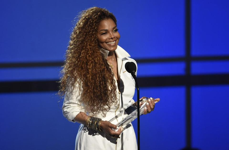"FILE - In this June 28, 2015, file photo, Janet Jackson accepts the ultimate icon: music dance visual award at the BET Awards at the Microsoft Theater in Los Angeles. Jackson is delaying her ""Unbreakable"" tour, saying Wednesday, April 6, 2016, she and her husband are planning their family and that she is under doctor's orders to rest. (Photo by Chris Pizzello/Invision/AP, File)"