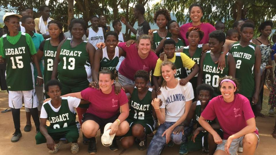 10nocatch- Reading High grad Justine Lyons (bottom) with the international team, working with colleagues with Shooting Touch, in Rwanda. (handout)