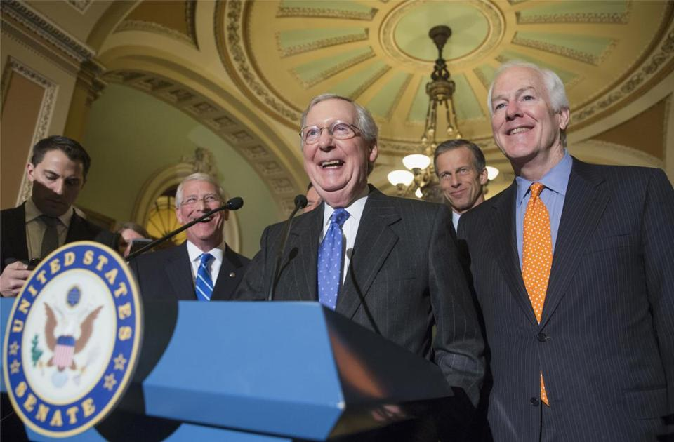 Senate Majority Leader Mitch McConnell of Ky., center, joined by, from second for left are, Sen. Roger Wicker, R-Miss., Sen. John Thune, R-S.D., and Senate Majority Whip John Cornyn of Texas, laughs while meeting with reporters on Capitol Hill in Washington, Tuesday, Feb. 23, 2016, following a closed-door policy meeting. Senate Republicans, most vocally McConnell, are facing a high-stakes political showdown with President Barack Obama sparked by the recent death of Supreme Court Justice Antonin Scalia. Republicans controlling the Senate — which must confirm any Obama appointee before the individual is seated on the court — say that the decision is too important to be determined by a lame-duck president. (AP Photo/J. Scott Applewhite)