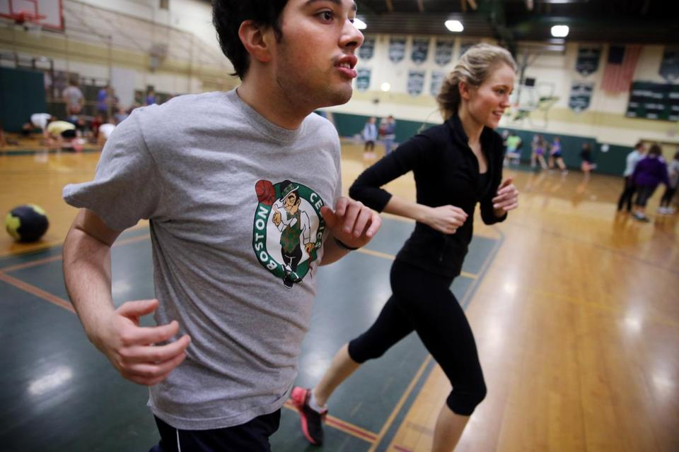 Cabral, left, ran with senior Mary Sabourin during the Unified Track program at Nashoba Regional High School in Bolton.