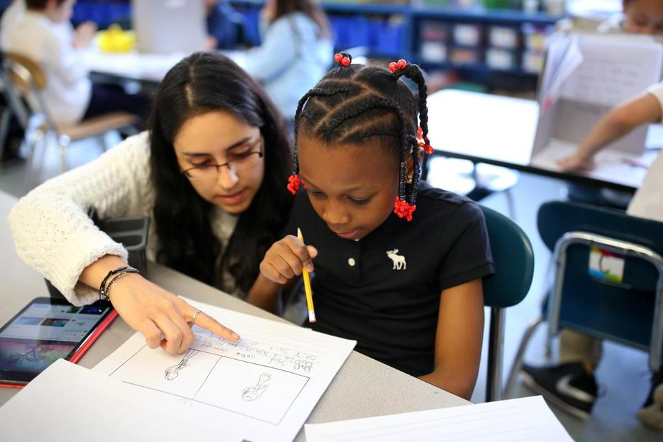 04082016 Boston Ma First grade teacher Ana Soto (cq) left with student Aayana Kelley (cq) right inside her English Literacy Class at the Joseph Hurley School .Boston Globe /Staff Photographer Jonathan Wiggs