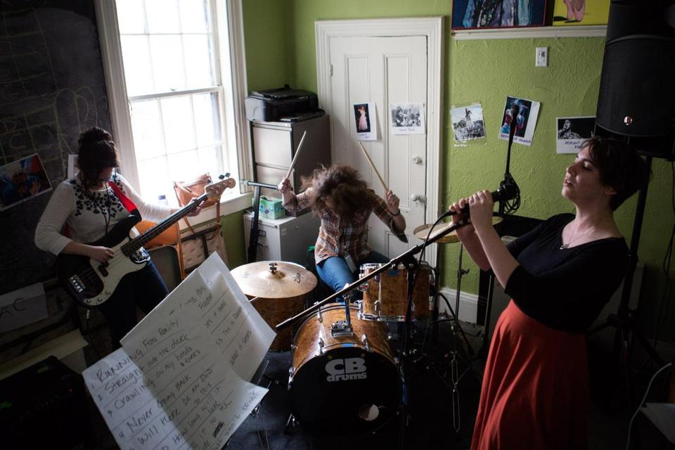 FRom left: Carolyn Berk, Wendy Grus, and Schyler Versteeg rehearsed a song during a band practice session at Ladies Rock Camp Boston.