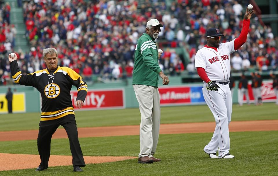 Bobby Orr, Bill Russell, and David Ortiz, along with Ty Law (not pictured), threw out the first pitches Monday.