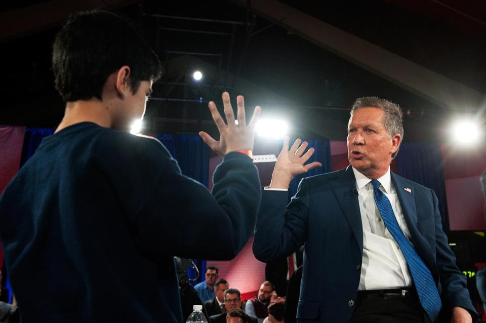 Republican presidential candidate John Kasich high-fived a supporter during a campaign stop in Queens on March 30.