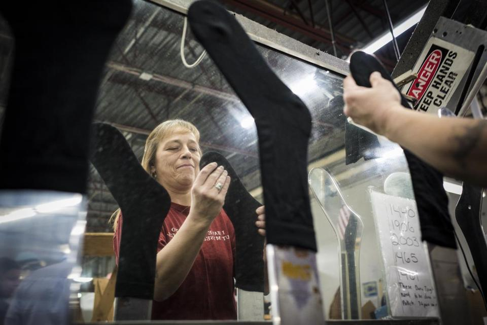 BillieJo Gilmore works fitting knit and washed Darn Tough Vermont socks onto forms so they can be steam pressed ahead of packaging at Cabot Hosiery Mills INC. in Northfield, Vermont on Wednesday, April 13, 2016. (Ian Thomas Jansen-Lonnquist for The Boston Globe)