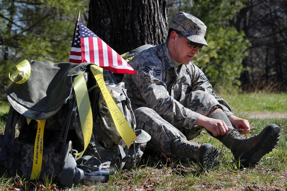 Air Force reservist Corey Costa tied his boot while taking a break.
