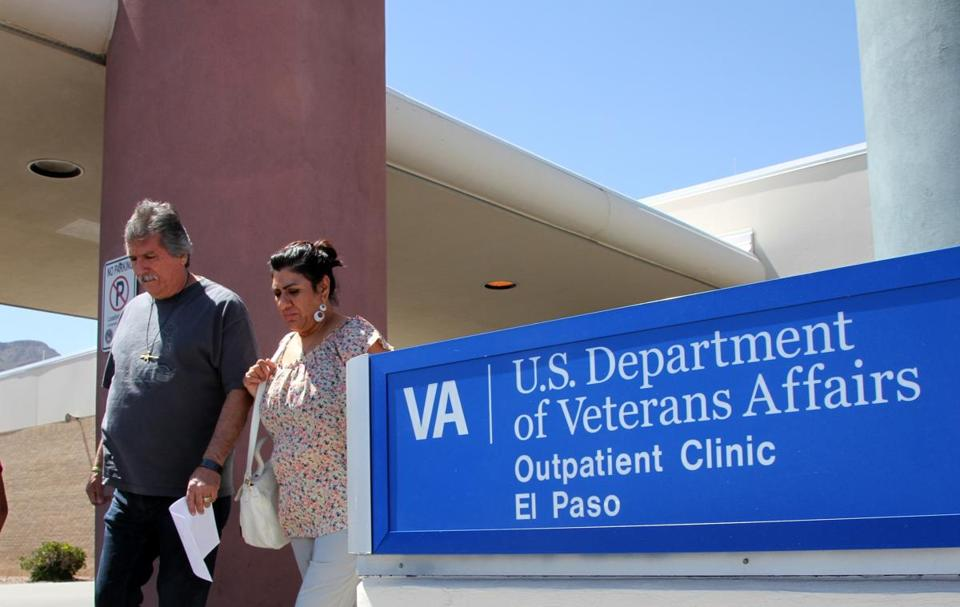 FILE - In this June 9, 2014, file photo, David and Marianne Trujillo exit the Vetarans Affairs facility in El Paso, Texas. An internal Department of Veterans Affairs investigation found that schedulers in Texas routinely misreported when patients actually wanted to see a doctor or get some other type of care, making it impossible to track delays in the care they received. (AP Photo/Juan Carlos Llorca, File)