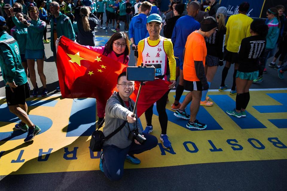 Runners from China took a photo at the Boston Marathon's finish line on Boylston Street.
