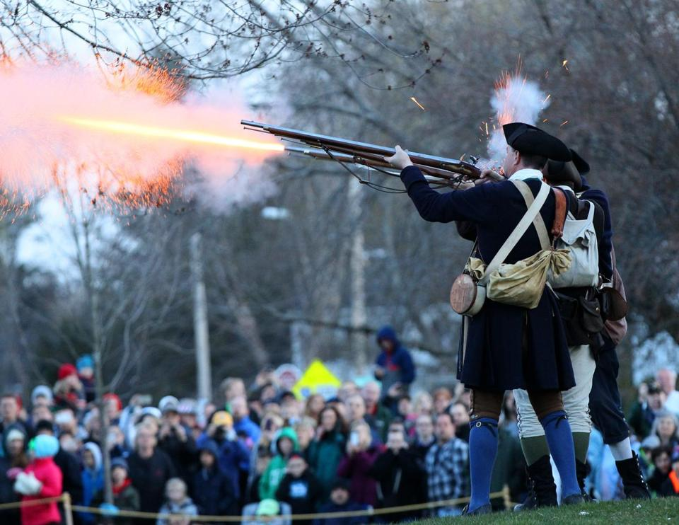 Joanne Rathe/Globe staffMinutemen fired their weapons Monday morning as part of the reenactment of the 1775 Battle of Lexington.