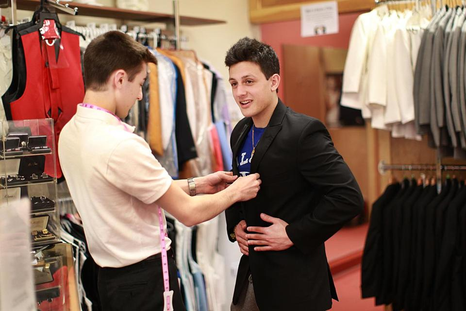 At Russo Tux Dresses and Limousine in Stoneham, 17-year-old Michael Schiappa tried on a tux.