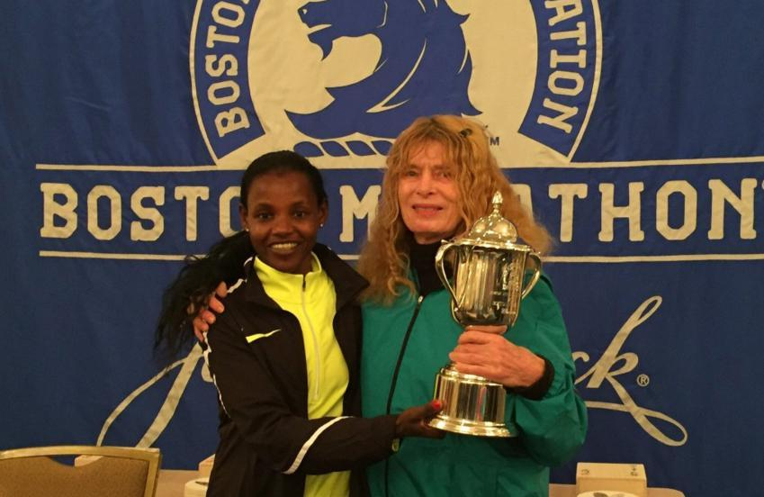 In honor of her unofficial run in 1966, Bobbi Gibb (right) was given the 2016 trophy by winner Atsede Baysa.