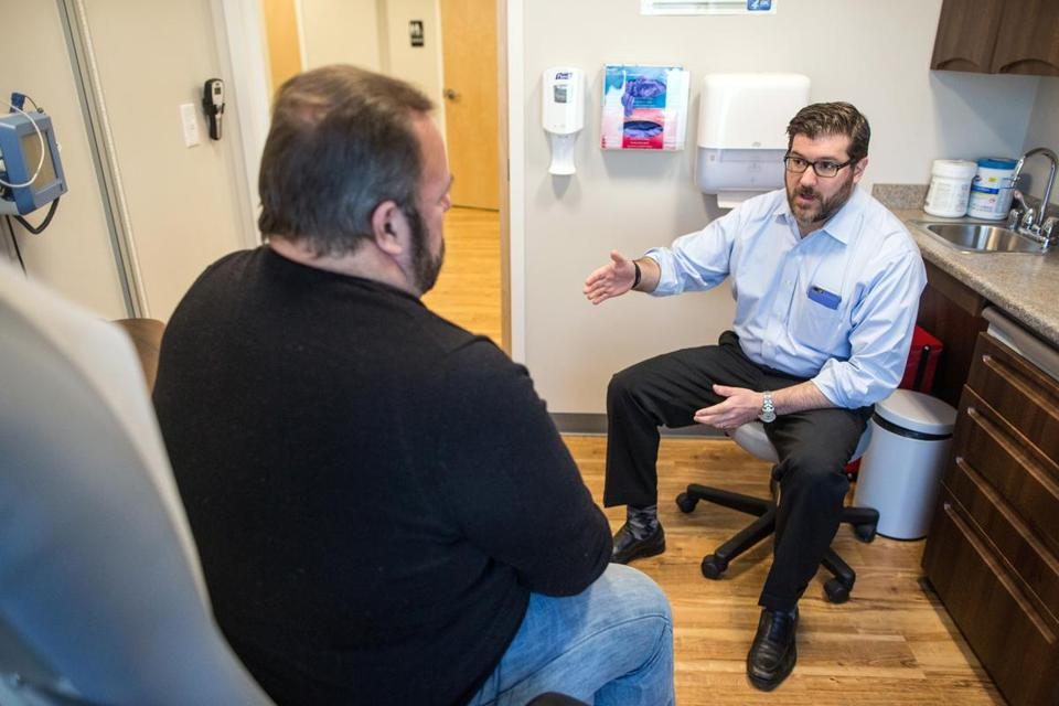 Dr. Jeffrey Gold (right) consulted with patient David Bergstrom at Gold Direct Care in Marblehead. Gold says he could not accept the standard model for medical practice.