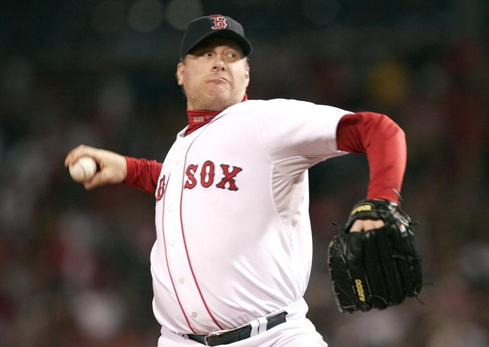 Curt Schilling pitches in game six of the ALCS in 2007.