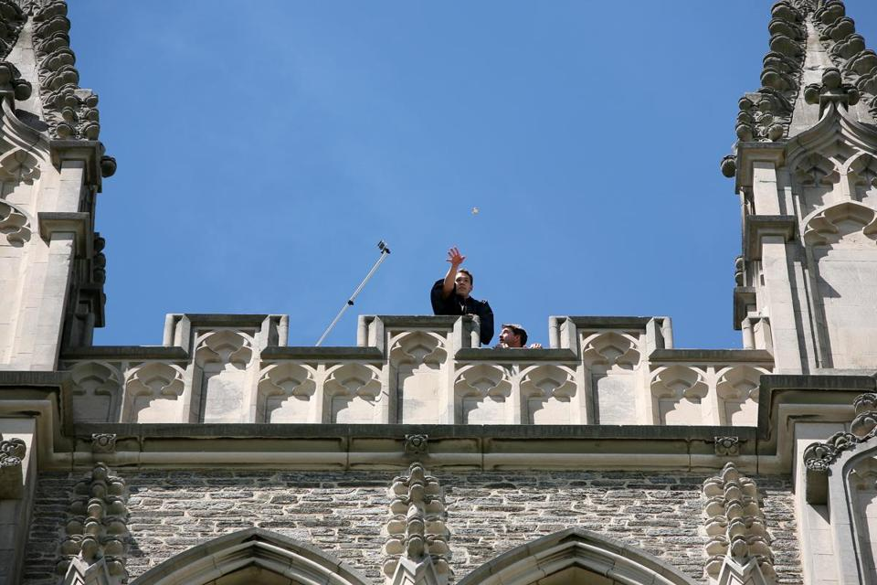 A pocket watch was thrown from the spire of the Williams College chapel; if it breaks, it means good luck for the graduating class.