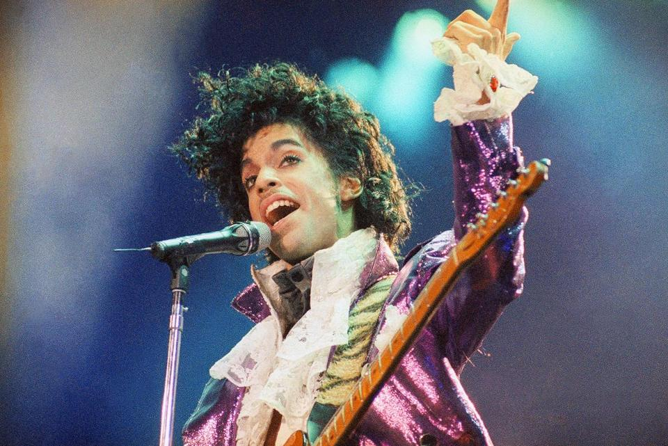 "FILE - In this Feb. 18, 1985 file photo, Prince performs at the Forum in Inglewood, Calif. Prince, widely acclaimed as one of the most inventive and influential musicians of his era with hits including ""Little Red Corvette,"" ''Let's Go Crazy"" and ""When Doves Cry,"" was found dead at his home on Thursday, April 21, 2016, in suburban Minneapolis, according to his publicist. He was 57. (AP Photo/Liu Heung Shing, File) -- 21prince"