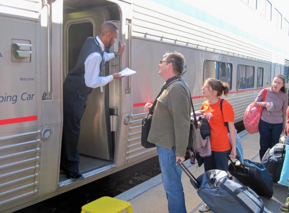 A Southwest Chief sleeping car attendant, Anthony Buck Jr., checks a ticket in Albuquerque.