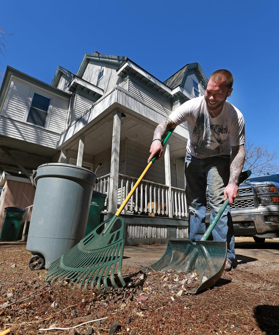 "04/21/16: Lynn, MA: Joe Richards, a resident of ""Chelsea's House"", the first sober house that met state standards and was certified, is pictured as he does some raking in the back yard. (Globe Staff Photo/Jim Davis) section:health/science topic:25soberhouse"