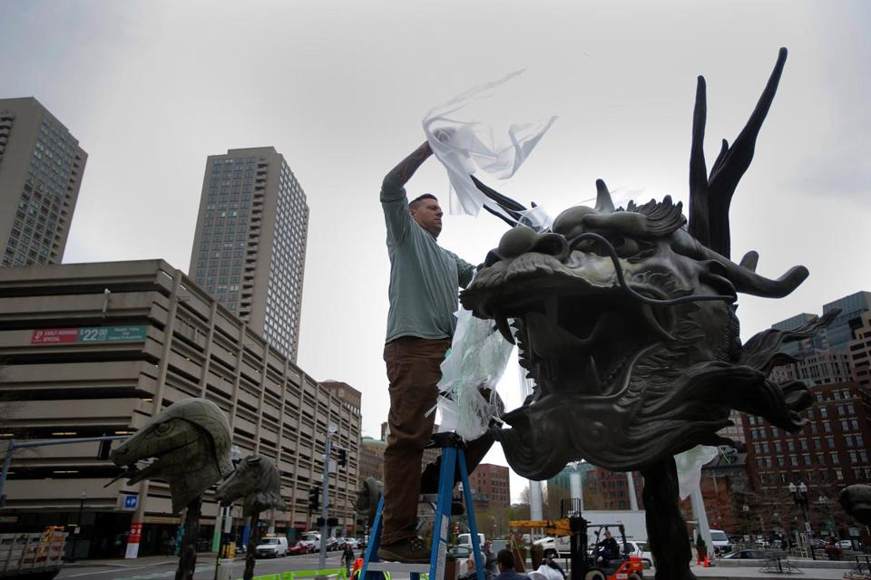 BOSTON, MA - 04/25/16 - Eric Ventura (cq) from More Specialized Transport of New Jersey install artist Ai Wei Wei's Chinese zodiac sculptures on the Rose Kennedy Greenway near Milk Street. The sculptures each weigh around 800 pounds, and were previously exhibited in Chicaco. There are several sets of the sculptures. The installation will come down sometime in October. Lane Turner/Globe Staff Section: ARTS Reporter: joe incollingo Slug: greenwayart