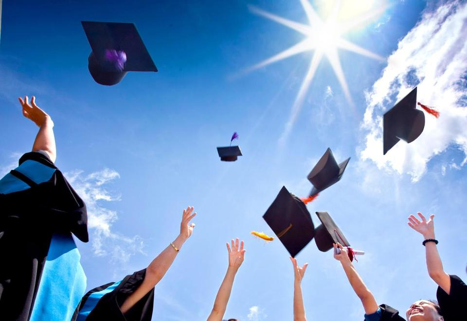Students with congratulations throwing graduation hats in the air celebrating; Shutterstock ID 115335826; PO: mag 5/1
