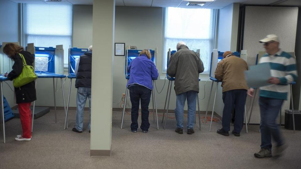 Voters cast their ballots in Cumberland, Rhode Island.