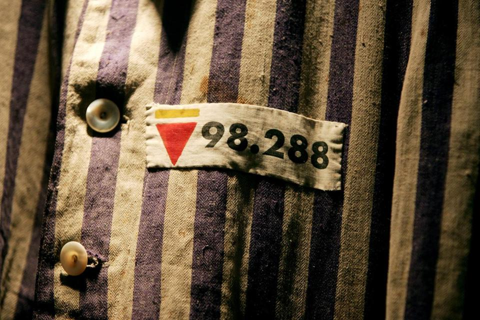 The prison uniform of Auschwitz survivor Leon Greenman is displayed in 2004 at the Jewish Museum in London, England.