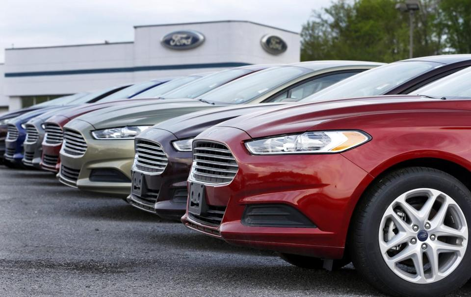 FILE - In this Wednesday, May 8, 2013 file photo, a row of new 2013 Ford Fusions are on display at an automobile dealership in Zelienople, Pa. U.S. retail sales fell last month as Americans cut back on their car purchases, the latest sign that consumers are reluctant to spend freely. Sales at retail stores and restaurants fell by a seasonally adjusted 0.3 percent in March, the Commerce Department said Wednesday, April 13, 2016, following a flat reading in February and a drop in January. (AP Photo/Keith Srakocic, File)