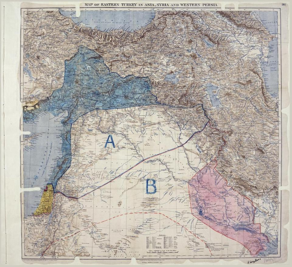 This is a detail of a Royal Geographical Society map signed by Mark Sykes and François Georges-Picot in 1916. It shows eastern Turkey in Asia, Syria and Western Persia, and areas of control and influence agreed between the British and the French. The thick line through the middle is the Sykes-Picot line.