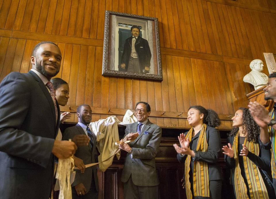 Dr. S. Allen Counter (center), of the Harvard Foundation, unveils the portrait of Richard Theodore Greener.