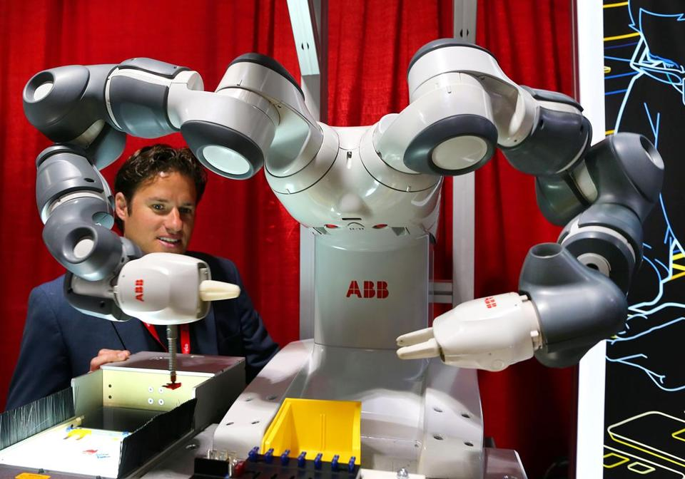 Nicolas De Keijser of ABB watched a robot in action at the Boston robotics conference.